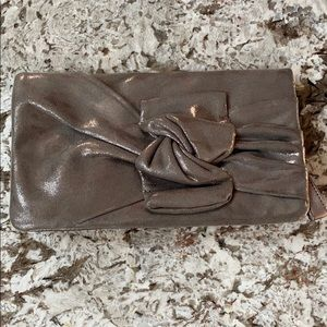 Under-loved Joujou evening handbag. Metallic w bow